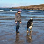 Dog on beach near Windyhill Cottage